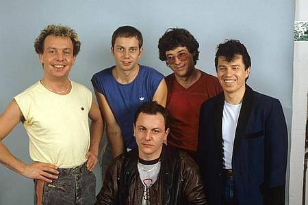 Die bayerische Rockgruppe Spider Murphy Gang um Drummer Franz Trojan (vorne sitzend). Foto: picture alliance dpa/Archivbild